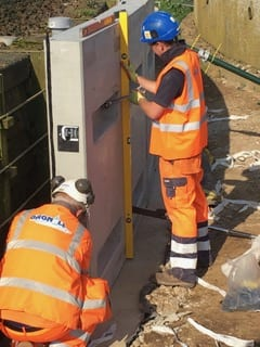 Installation of a Pre-cast Concrete Filter Wall System around an existing collapsing structure