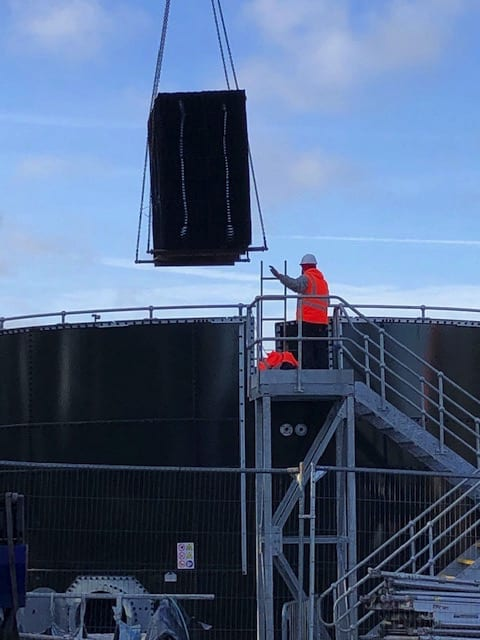Installation of structured Plastic Filter Media into new glass coated steel structure